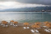 Evening In Gelendzhik Bay. In The Foreground Is A Pebble Beach, Sun Loungers And Straw Umbrellas Fro poster