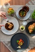 Top view of business lunch - different tasty dishes on the table table from high view angle. poster