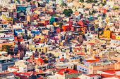 Guanajuato. Vibrant bird view cityscape of mexican city of Guanajuato at sunset with tilt-shift effe poster
