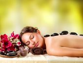 Spa Stone Massage. Beauty Treatments. Beautiful Girl Getting Spa Hot Stones Massage Outdoor. Spa Sal