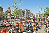 AMSTERDAM - APRIL 30: Big crowds in orange from people partying at the celebration of queensday on A