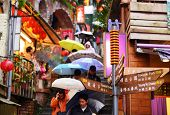 JIUFEN, TAIWAN - JANUARY 17: Tourists walk down famed steps January 17, 2013 in Taipei, TW. A gold mining town developed under Japanese rule, the city now attracts visitors for its nostalgic scenery.