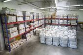 MOSCOW - JUNE 5: Small warehouse with lot of big white sacks  in Caparol factory on June 5, 2012 in