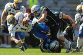 INNSBRUCK, AUSTRIA - APRIL 28:  QB Chris Gunn (#12 Giants) is tackled DL Bene Brugnara (#90 Raiders)