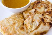 image of curry chicken  - Indian Roti Prata with Chicken Meat and Curry Sauce Closeup - JPG