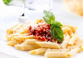 Pasta. Penne Pasta with Bolognese Sauce, Parmesan Cheese and Basil on a Fork. Italian Cuisine. Medit