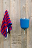 image of lavabo  - rural plastic hand wash tool and towel hang on wooden wall - JPG