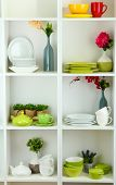 Beautiful white shelves with tableware and decor