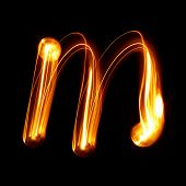 M - Created by light lowercase letters