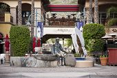 PALM SPRINGS, CA - JAN 17: The heart of downtown Palm Springs, CA has a statue of Sonny Bono who was