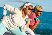 Senior Ladies Working Out On Beach.