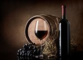 Wine with barrel and hay