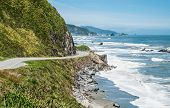 stock photo of south-western  - A scenic road winds along the western shore of New Zealand - JPG