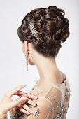 Refinement And Sophistication. Stylish Woman With Festive Coiffure