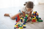 pic of human pyramid  - Child playing with blocks at home - JPG