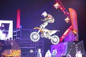 MOSCOW - MAR 02: Jump on a motorcycle with acrobatic stunts on the festival extreme sports Breakthro