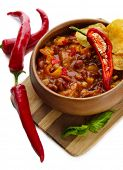 Chili Corn Carne - traditional mexican food, in wooden bowl, on  wooden board, isolated on white