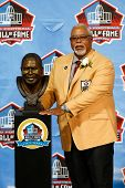 CANTON, OH-AUG 3: Former defender Curley Culp poses with his bust during the NFL Class of 2013 Enshr