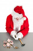 Santa had damaged his piggy bank and is counting poor money