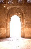stock photo of palace  - Nice arch door in ancient Arabian palace Alhambra - JPG