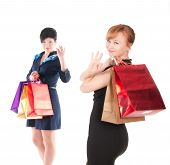 Portrait Of Elegant Two Women With Shopping Bags