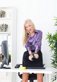 stock photo of utp  - beautiful blonde in the Office hand tied wire UTP - JPG