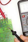 stock photo of  multimeter  - Digital multimeter and electronic parts are tested - JPG