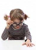 Little girl with thick bottle glasses
