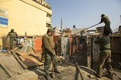 KATHMANDU, NEPAL - DEC 24, 2013: Unknown nepalese police during a operation on demolition of residen