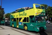 Green and yellow tour bus, Seville.