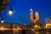 KRAKOW, POLAND - APR 7, 2014: St. Mary's Church on Rynek Glowny (Market Square) in night time. Rynek Glowny - roughly 40,000 m2 is largest medieval town square in Europe.