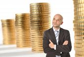 picture of brazilian money  - Attractive Happy Young Business Man with bald head Thinking and Dreaming of Big Money on gold coins stacks background - JPG