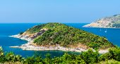 stock photo of budha  - Phromthep cape viewpoint with a budha statue over the blue sky Phuket - JPG