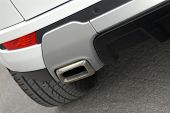 stock photo of exhaust pipes  - exhaust aluminium pipe for a sporty SUV - JPG