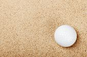 Golf Ball On The Sand