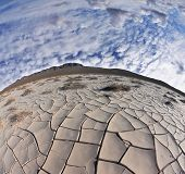 Cracked clay crust is vast desert - takyr. California, USA. Photo taken fisheye lens