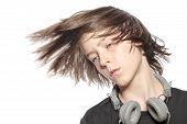 Moving Cool Teenager Boy With Headphones, Isolated On White