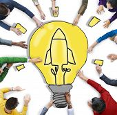 Group of People with Light Bulb and Rocket Symbol