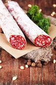 Italian salami  on wooden background