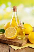 Lemon oil on table on light background