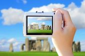 foto of stonehenge  - camera taking photo with Stonehenge Stonehenge an ancient prehistoric stone monument near Salisbury Wiltshire UK - JPG