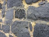 Close-up Of A Old Cemented Lava Stone Wall With Small Shells