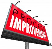 Process Improvement words on a billboard or sign ot illustrate an overhaul of outdated processes, sy