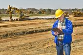 Foreman Keeping Records On Job Site