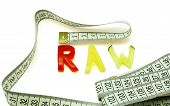 Word raw composed of slices of different vegetables with measuring tape