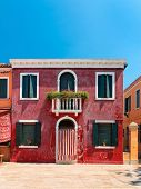 Colorful houses taken on Burano island , Venice, Italy in summer time. Positive color makes beautifu