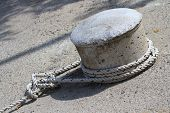 pic of bollard  - Sea Knot of the rope on the bollard closeup - JPG