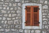 Window Closed Brown Shutters On A Stone Wall