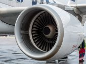 Closeup of passenger airplane engine parked at the airport