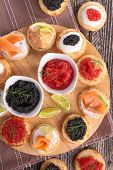 canape with caviar, salmon and cheese